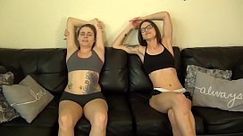 Two girls lick their armpits after exercising