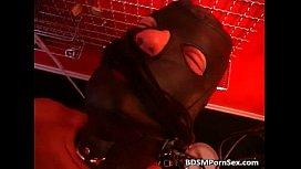 Masked slave is caught in BDSM play