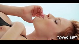 Solo hottie plays with her bald pink snatch in a solo action