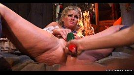 Stunning lesbian babes enjoy a big thick dildo