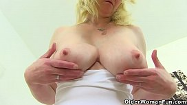 Big titted milf Fiona is pleasuring her pa osed clit