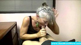 Mature m. with spex sucking cock