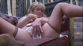Busty mature babe in stockings and panty tease