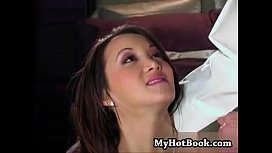 Katsuni has a sly look in her eyes as she looks up