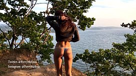 Melissa Candy on a sea coast show off her pussy and ass..