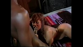 Redhead witch sucks hard black cock and masturbates with her big tits