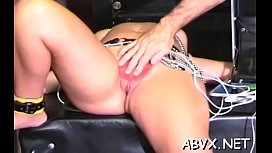 Undressed woman stands and endures coarse bondage amateur