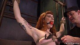 Gagged redhead doggy banged in bdsm threesome