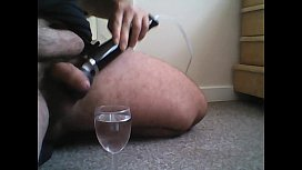 Cumming into a glass of water