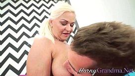 Busty grandma takes cum facial