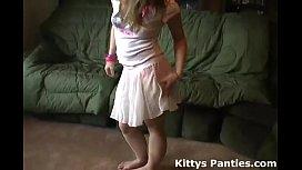 Petite teen Kitty flashing her panties in a tiny miniskirt