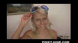 Blond and blue-eyed teen Pinky June fully naked on the rocks