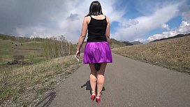 Surprise under the skirt. Walk on a public road with anal plug in a big ass.