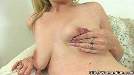 British milf Ashleigh squeezes her leaking nipples