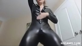 Model in Latex Catsuit Dancing