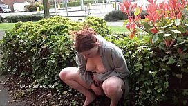 Outdoor peeing and public nudity of pissing amateur redhead Isabel Dean roaming