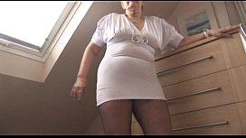Curvy mature lady in tight dress and crotchless pantyhose