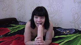 Brunette with hairy pussy masturbates with a huge dildo and sucks a rubber dick. Gaping hole and fetish.