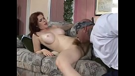 American badass fucks redhead Mae Victoria with big jugs hard on the couch
