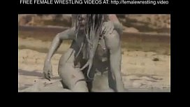 Girls wrestling in the mud