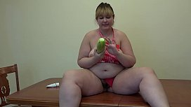 Beautiful BBW gets fucked with a big zucchini on the kitchen table. Organic masturbation and gaping hairy pussy.