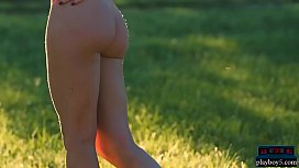 Petite MILF Lily Chey outdoor striptease and posing