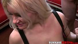 Bukkake loving MILF drooling on dicks while sucking them