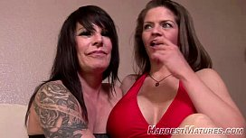 50plus Moms performing a lesbian act