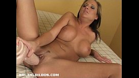 Sexy blonde fills her pussy with a thick brutal dildo