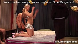Oiled up MILF fingered and fucked in awesome gangbang