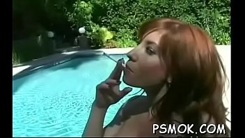 Breasty bombshell enjoying a drink and a smoke whilst masturbating
