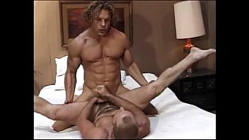 Muscular studs fuck hardcore in front of bored film crew