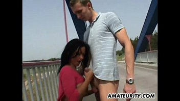Busty German Milf sucks and fucks outdoor on a bridge preview image