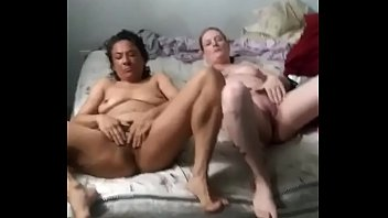 Interracial lesbians make out and show off pussies