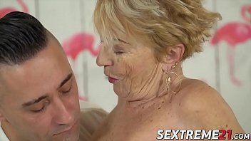Horny granny chewing a cock before banging it very savagely