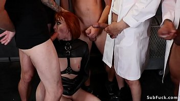Redhead in strait jacket gangbang fucked