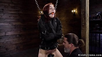 Redhead in doggy bondage gets catle prod