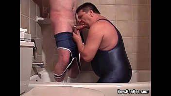 Pervy guy pissing in boyfriend's mouth while he's sucking his stiffed cock