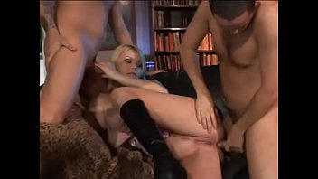 Blonde in boots and lingerie takes couple of cocks deeply inside all her holes