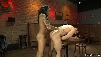 Busty tattooed shemale bangs man in bar