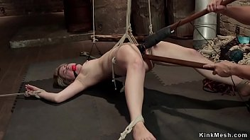 Hogtied blonde in backbend position