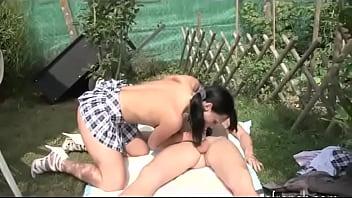 Nasty hot girl seduces boy in the garden