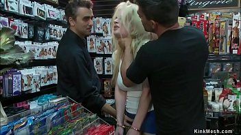 Busty blonde anal fucked in sex shop