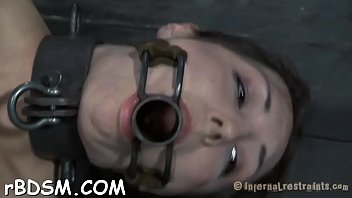 Hottie is chained in shackles during hardcore bdsm t.