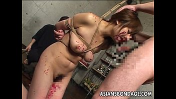 Asian slut has a cock to suck as she's tied up
