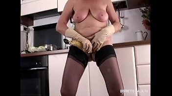 My wife's slut in stockings masturbates in the kitchen with a ladle and a banana