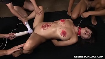 Yayoi Yanagida is moaning during a hot wax torture session