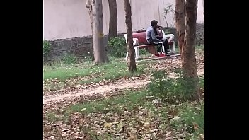 Indian couple kissing in park 1