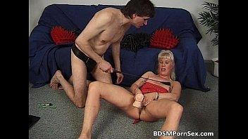 BDSM play where blonde slides big rubber
