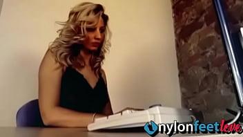 Blonde secretary in lingerie and black RHT stockings
